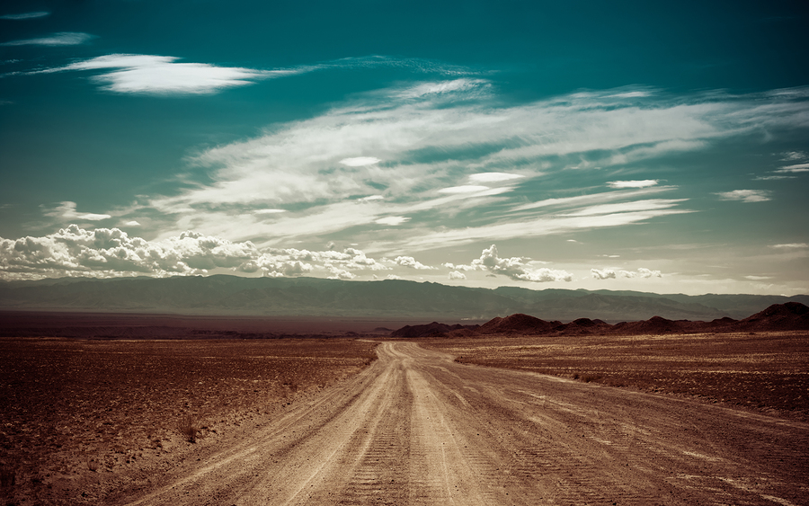 bigstock-Empty-Rural-Road-Going-Through-48243419