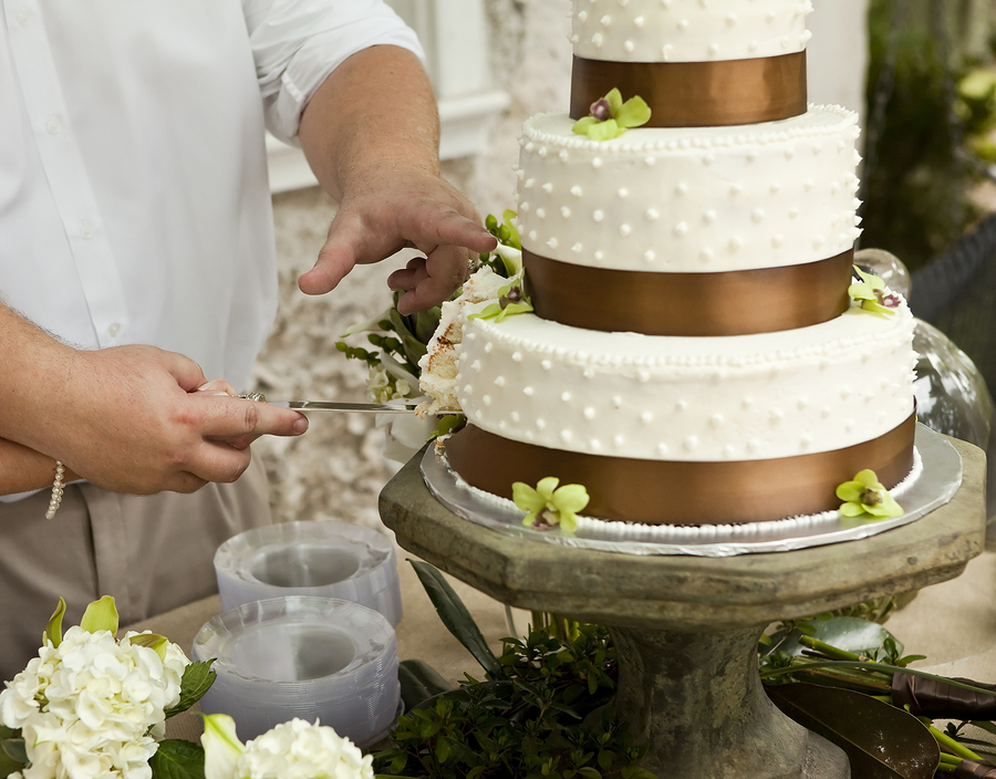 cutting the wedding cake, focus on hands