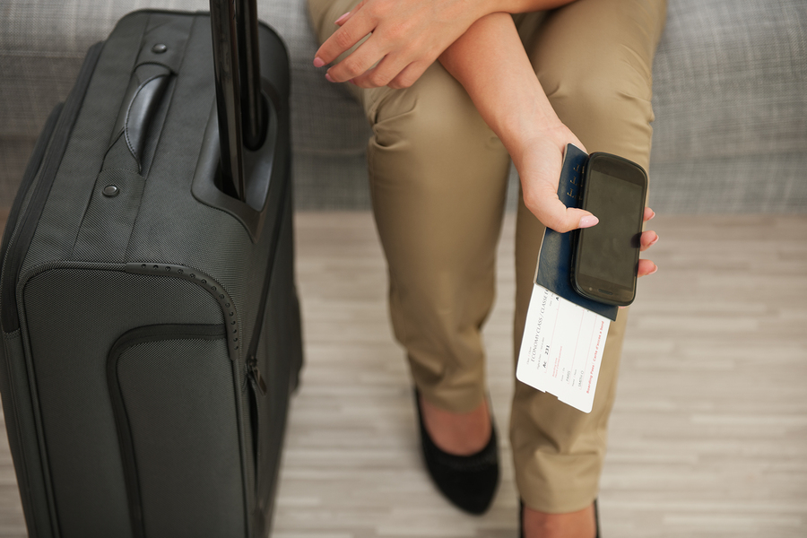 Closeup On Female Hand Holding Mobile, Passport And Air Ticket N