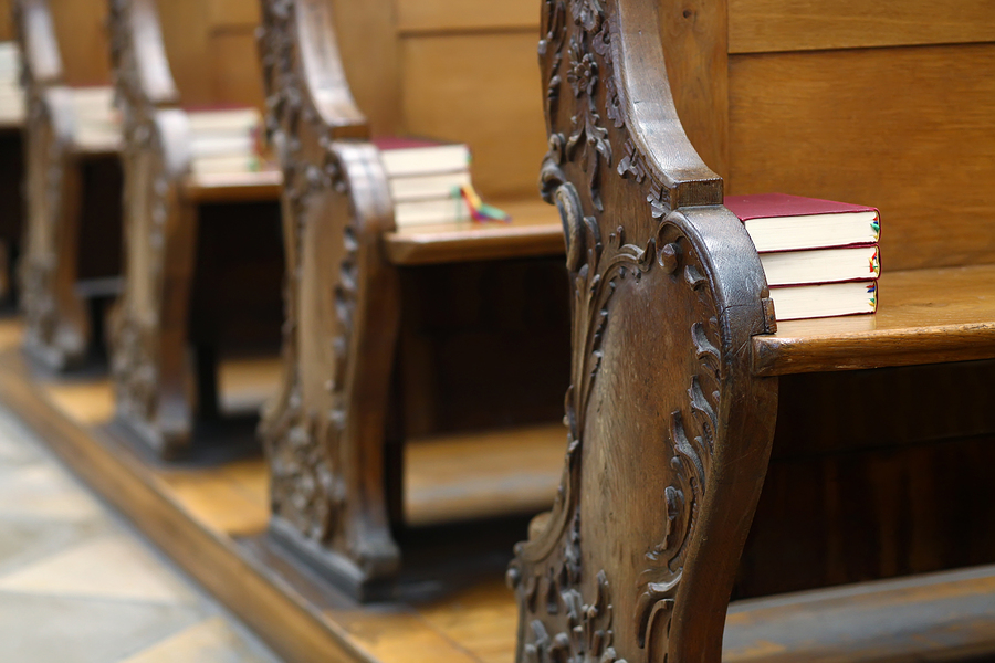 Detail of the church seats with Bibles